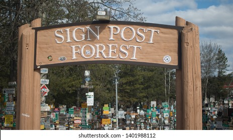 Watson Lake, Yukon, Canada - 5/12/2019: Entry to the Sign Post Forest: a collection of signs and one of the most famous of the landmarks along the Alaska Highway, started by a homesick GI in 1942