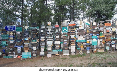 Watson Lake, Yukon, Canada - August 13, 2017: The Sign Post Forest is Watson Lake's most famous attraction.  Travelers from all over the world have been bringing signposts into the park since 1942.