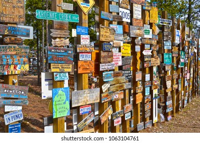 WATSON LAKE, YUKON, CANADA - MAY 19, 2012: The Sign Post Forest is the famous attraction of Watson Lake on the Alaska Highway. Travelers from all over the world bring signs and put them on poles.