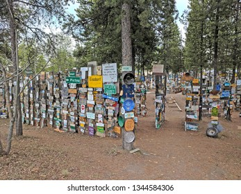 Watson Lake, Yukon, Canada - May 20, 2018: Sign Post Forest, a collection of signs and one of the most famous of the landmarks along the Alaska Highway, started by a homesick GI in 1942