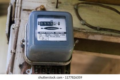 Watt hour Electric meter measurement tool at old house.