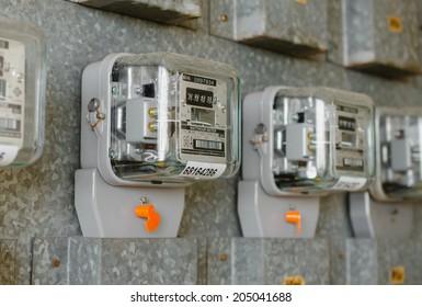 Watt hour Electric meter measurement tool at apartment.