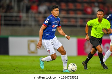 Wattana Playnum (Blue)of SCG Muangthong United in action during The Football Thai League between Bangkok United and SCG Muangthong United at True Stadium on March 02,2019 in Pathum Thani, Thailand