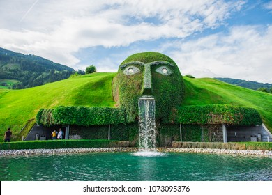 WATTENS, AUSTRIA, May 15, 2017. Fountain with giant head spitting water into a pond at swarovski Kristallwelten in Wattens, Austria. swarovski  crystal park. swarovski museum in austria