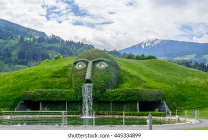 WATTENS (INNSBRUCK), AUSTRIA - 13 MAY 2016: Panoramic view to the main waterfall entrance into the Swarovski Crystal Worlds (Kristallwelten) museum of glass art. Mountain peaks in the background