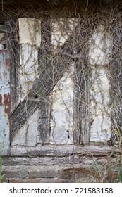 Wattle and daub wall of barn in Normandy farmyard