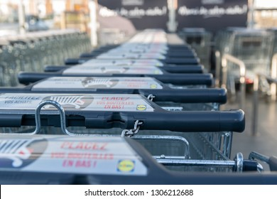 Wattrelos,FRANCE-January 20,2019: Close-up shopping trolleys Lidl supermarket.Lidl Stiftung & Co. KG  is a German global discount supermarket chain.