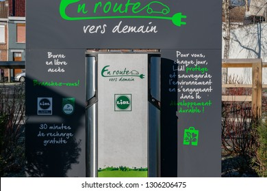 Wattrelos,FRANCE-January 20,2019: Distributor for charging electric car current in Lidl supermarket parking.Lidl Stiftung & Co. KG  is a German global discount supermarket chain.