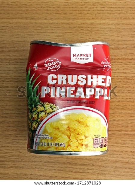 Waubedonia, WI – April 23, 2020: Crushed Pineapple Can, red and yellow, which is actually crushed. illustrative editorial.
