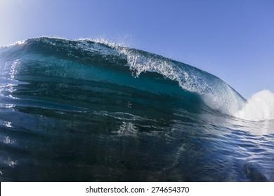 Wave Blue Ocean wave hollow crashing blue water swimming closeup.