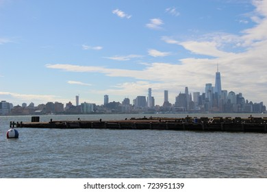 Wave breaker with the background of water and Manhattan