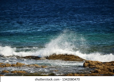 The wave breaks on the rocky shore. Atlantic Ocean. Los Hervideros, Lanzarote, Canary Islands, Spain