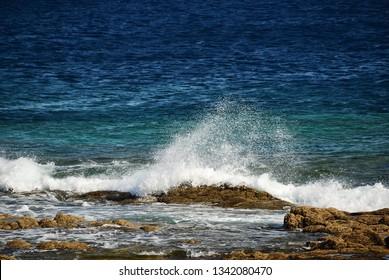 The wave breaks on the rocky shore. Atlantic Ocean. Los Hervideros, Lanzarote, Canary Islands, Spain