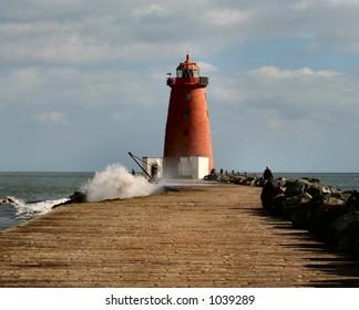 Wave Crashes into Poolbeg Lighthouse