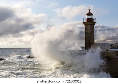 Wave crashing in the Lighthouse at the Atlantic ocean coast