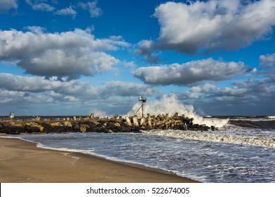 A wave crashing on a Jetty in point Pleasant, NJ at Manasquan Inlet. The large waves are the result of Hurricane Joaquin that is well out to sea in October 2015.