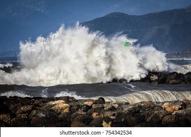 Wave crashing over breakwater