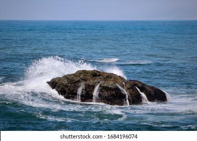 Wave crashing over ocean rock along northern California coast