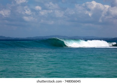 """A wave goes unridden at """"Pitstops"""" surf break in the Mentawai Islands off Sumatra's West Coast. There are many surf breaks in this area that people travel from around the world to surf camps or boats."""