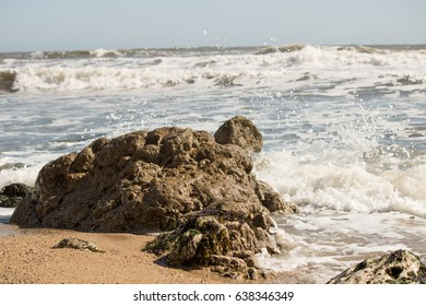 A wave hitting rocks