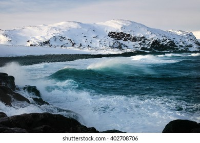 A wave hitting the shore in the Russian North