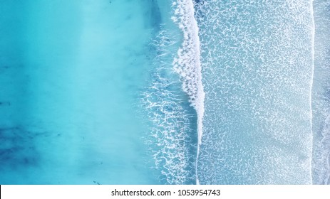 Wave on the beach as a background. Beautiful natural background at the summer time