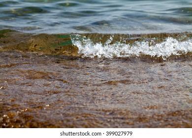 Wave and sand closeup