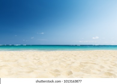 Wave of the sea on the sand beach in Punta Cana, Dominican Republic. Vintage summer background.