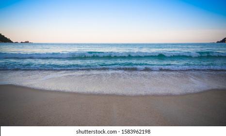 Wave of the sea on the sand beach, summer sand beach background soft focus,grain,Select focus, blur