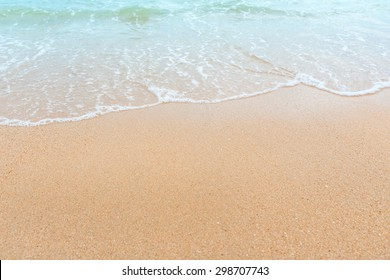 Wave of the sea on the sand beach, summer sand beach background