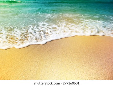 Wave of sea water and sand