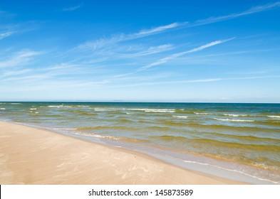 Wave sea white sand beach, Baltic Sea near Leba, Poland