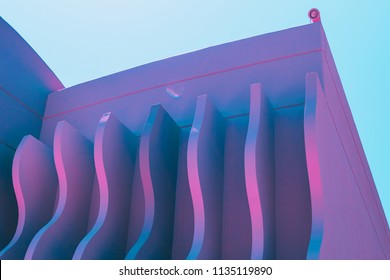 wave shapes on the hotel's wall. ultra violet holographic colors