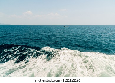 Wave of ship on water surface in the sea