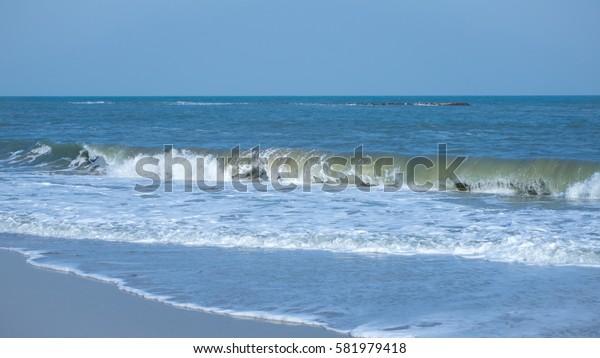 Wave at shore, along the beach