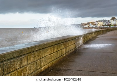 wave slashes over a wall in Herne Bay, kent, uk on a stormy windy day winter day.