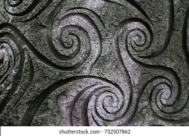 Wave spiral pattern on a stone