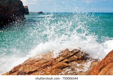 wave and splashes on beach of cathedrals in ribadeo, Galicia, Spain