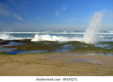 Wave splashing against rocks at the beach