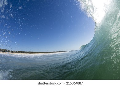 Wave Tubes/ a perfect wave pitches over creating a tube. On the Sunshine Coast of Queensland, Australia.