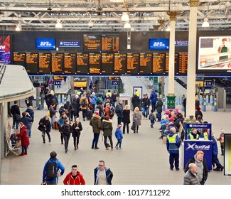 Waverley train station, people looking at information boards on the concourse. Edinburgh city, Scotland UK. February 2018 2018