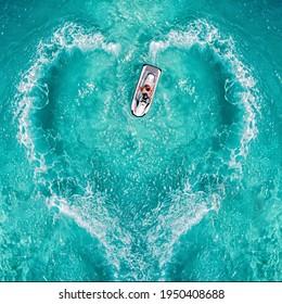 Waverunner aquabike splash love heart top symbol water jet drive or jet pump. Aerial view water motorcycle Maldives watersports events