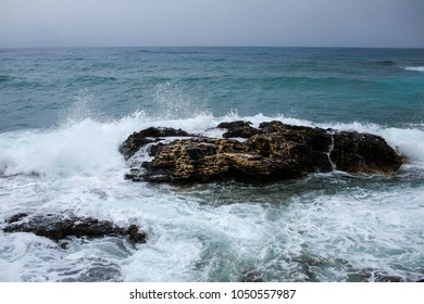 waves against rocks in the sea.