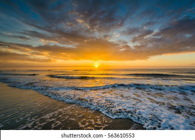 Waves in the Atlantic Ocean and sunrise, in Isle of Palms, South Carolina.