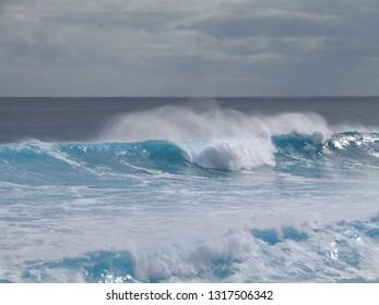 Waves in beach of Eastern Island. Rapa Nui. Isla de Pascua. Chile