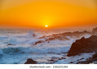 Waves at beautiful sunset in tsitsikama national park, south africa