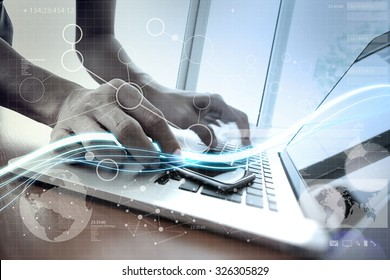 Waves of blue light and businessman using on laptop computer and smart phone with digital layer effect as concept