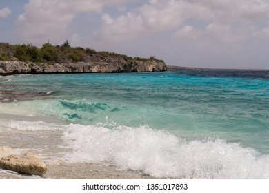 Waves breaking at a beautiful and idyllic coral beach on the west coast of the tropical island Bonaire in the former Dutch Antilles in the caribbean