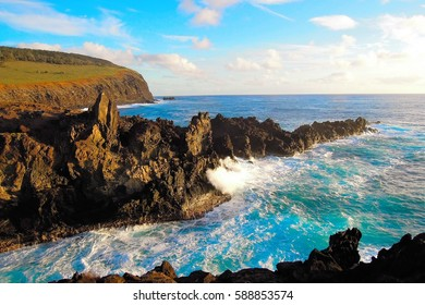 Waves breaking at the cliffs in front of the Ana Kai Tangata Cave close to Hanga Roa in Rapa Nui, Easter Island in Chile, South America