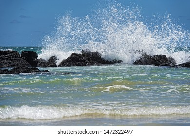 Waves breaking at the lava rocks of the coast, Isabela Island, Galapagos Islands, Ecuador